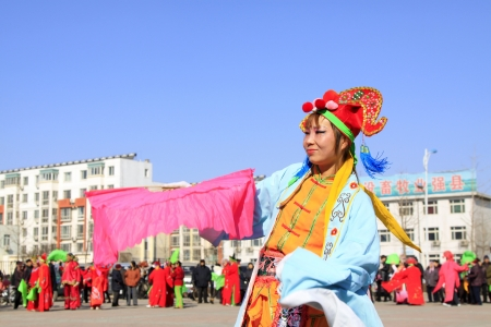 LUANNAN COUNTY OF HEBEI PROVINCE - FEBRUARY 19  During the Chinese Lunar New Year, people wear colorful clothes, yangko dance performances in the streets to express a new life of longing and yearning, on February 19, 2013, Luannan County, Hebei Province,