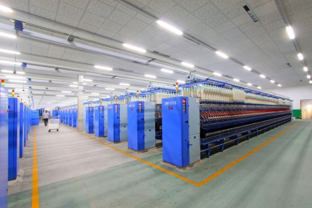 Luannan, November 20, 2012: Machinery and equipment in a spinning production line in the Zeao spinning company, in November 20, 2012, Luannan County, china. This is the largest of a modern spinning company in Hebei province.  Editorial