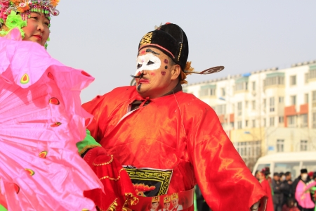 LUANNAN COUNTY OF HEBEI PROVINCE - FEBRUARY 20  During the Chinese Lunar New Year, people wear colorful clothes, yangko dance performances in the streets to express a new life of longing and yearning, on February 20, 2013, Luannan County, Hebei Province,