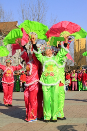 LUANNAN COUNTY - FEBRUARY 22  During the Chinese Lunar New Year, people wear colorful clothes, yangko dance performances in the street, on February 22, 2013, Luannan County, Hebei Province, China