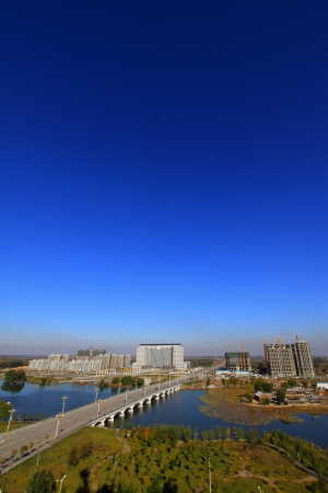 LUANNAN COUNTY OF HEBEI PROVINCE - OCTOBER 30: Bridges and buildings in the city on October 30, 2012, Luannan County, Hebei Province, China.