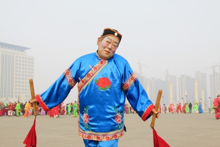 LUANNAN COUNTY - FEBRUARY 27  During the Chinese Lunar New Year, people wear colorful clothes, yangko dance performances in the streets, on February 27, 2013, Luannan County, Hebei Province, China