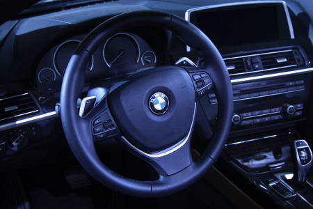 TANGSHAN - JUNE 2  BMW motor steering wheel in a car sales shop on June 2, 2013,Tangshan, Hebei Province, China