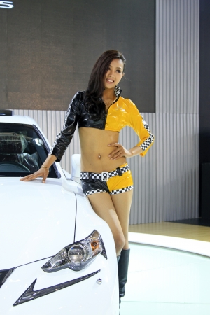 TANGSHAN - JUNE 2  Beautiful female model in an automobile exhibition on June 2, 2013,Tangshan, Hebei Province, China