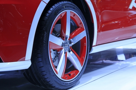 TANGSHAN - JUNE 2  Car wheels on display in a car sales shop on June 2, 2013,Tangshan, Hebei Province, China  Editorial