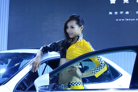 TANGSHAN - JUNE 2: Beautiful female model in an automobile exhibition on June 2, 2013,Tangshan, Hebei Province, China.