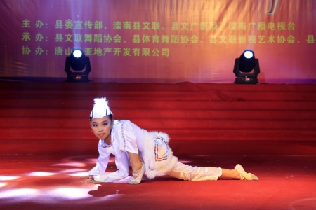 LUANNAN - JUNE 13: Dance performance on the stage on June 23, 2013, Luannan, Hebei Province, China.