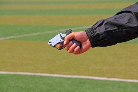 hand holding starting gun, closeup of photo Stock Photo - 20892965