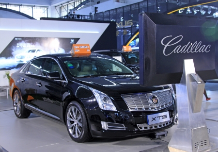 TANGSHAN - JUNE 2  Cadillac XTS luxury car on display in a car sales shop on June 2, 2013,Tangshan, Hebei Province, China