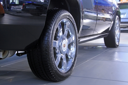 electroplating: TANGSHAN - JUNE 2: Car wheels on display in a car sales shop on June 2, 2013,Tangshan, Hebei Province, China.  Stock Photo