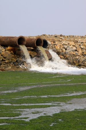 pollution water: rust metal pipes in the wild, north china