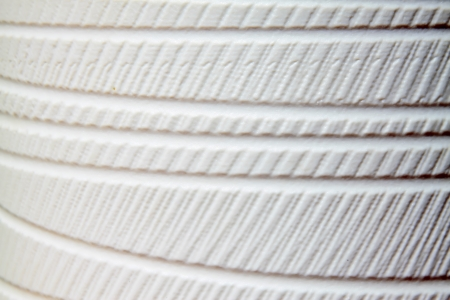 restore ancient ways: rope texture on white porcelain, closeup of photo