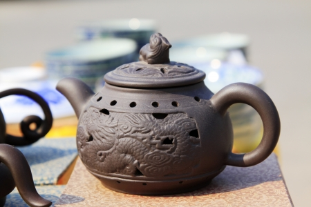 china violet arenaceous kettle, closeup of photo