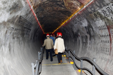 inclined: TANGSHAN - OCTOBER 18: The Inclined roadway in 70 meters underground in the Kailuan national mine park on october 18, 2013, tangshan city, hebei province, China.  Editorial