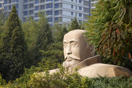 founders: TANGSHAN - OCTOBER 18: The statue of Mr Li dazhao, the founders of communist party of China in the DaZhao Park, on october 18, 2013, tangshan city, hebei province, China.