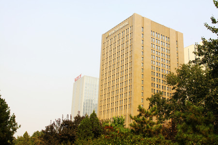 greening: TANGSHAN - OCTOBER 18: The Wanda plaza building scenery on october 18, 2013, tangshan city, hebei province, China.
