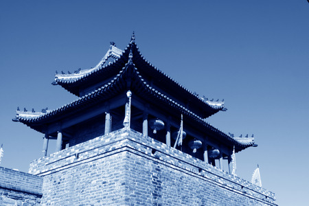 restore ancient ways: tower over a city gate, ancient Chinese style in a scenic spot, china