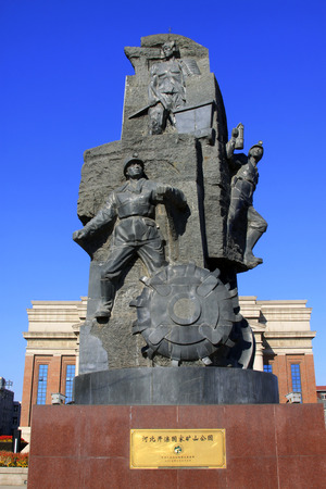 plaza of arms: TANGSHAN - NOVEMBER 4: The miners sculpture in the kailuan national mine park on november 4, 2013, tangshan city, hebei province, China. Editorial