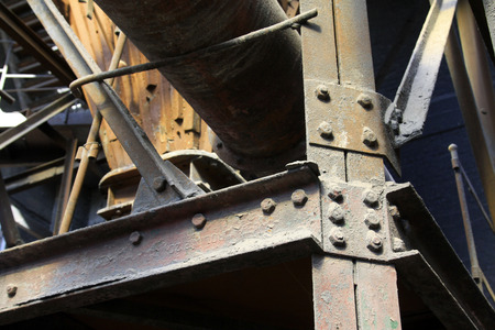 restore ancient ways: broken metal parts in a workshop, closeup of photo Stock Photo