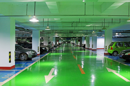 Underground parking lot with green floor