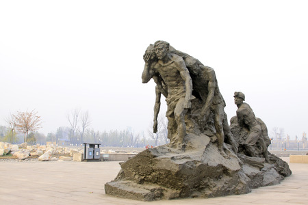 hebei province: TANGSHAN CITY - NOVEMBER 16: The seismic characters statue in the Tangshan earthquake ruins park, on november 16, 2013, tangshan city, hebei province, China.