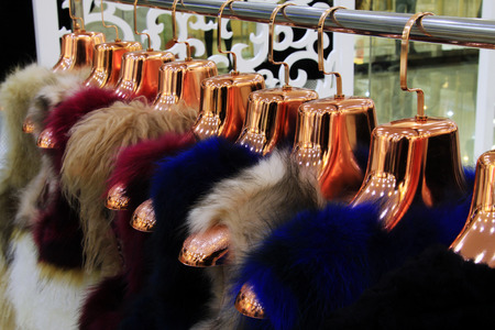 The Fine fur clothing on hangers in a store Stock Photo - 26350404