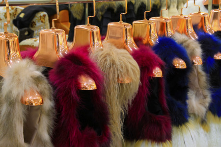 The Fine fur clothing on hangers in a store Stock Photo - 26350406
