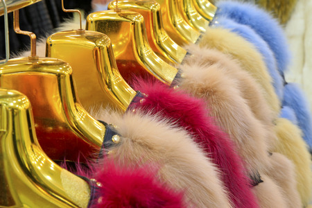 The Fine fur clothing on hangers in a store Stock Photo - 26350410