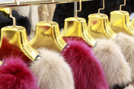 The Fine fur clothing on hangers in a store Stock Photo - 26350427