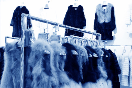 The Fine fur clothing on hangers in a store Stock Photo - 26346177