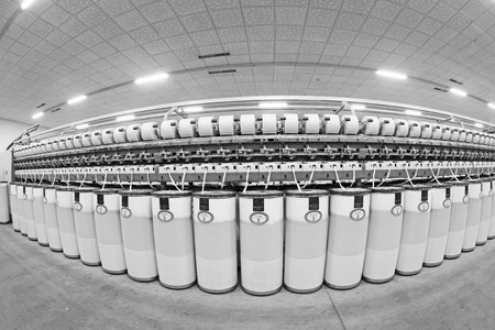 standardization: LUANNAN COUNTY - DECEMBER 20: The combed cotton production line and plastic bucket in the ZeAo spinning LTD., on December 20, 2013, Luannan county, hebei province, China.   Editorial
