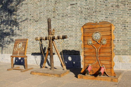 bundling: LUAN COUNTY - NOVEMBER 10: The ancient torture exhibition on november 10, 2013, Luan county, hebei province, China.  Editorial