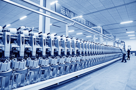 standardization: LUANNAN COUNTY - DECEMBER 20: The mechanical equipment was running in a production workshop, in the ZeAo spinning LTD., on December 20, 2013, Luannan county, hebei province, China.   Editorial