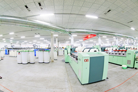 combed: LUANNAN COUNTY - DECEMBER 20: The combed cotton production workshop in the ZeAo spinning LTD., on December 20, 2013, Luannan county, hebei province, China.