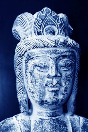 straightforward: Chinese traditional style religious figure stone works, closeup of photo