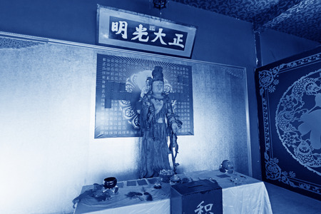 righteous: LUAN COUNTY - NOVEMBER 10: The word frank and righteous written on the board and buddha figure, November 10, 2013, Luan county, hebei province, China.