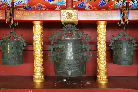 luxuriant: BEIJING - DECEMBER 22: The words chinese chimes, keep forever  written on the bronze surface in the hall, in the Imperial Ancestral Temple, December 22, 2013, Beijing, China.   Editorial