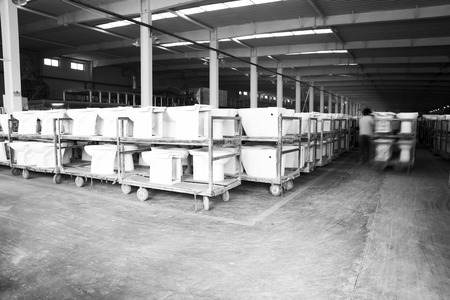 closestool: LUANNAN COUNTY - JANUARY 5: The worker and ceramic closestool products assemblies in a warehouse, in the ZhongTong Ceramics Co., Ltd. January 5, 2014, Luannan county, Hebei Province, China.