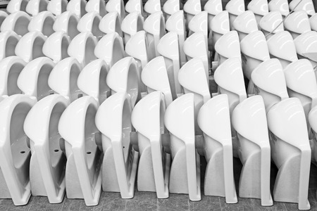 closestool: LUANNAN COUNTY - JANUARY 5: The neat rows of ceramic closestool products assemblies in a warehouse, in the ZhongTong Ceramics Co., Ltd. January 5, 2014, Luannan county, Hebei Province, China. Editorial