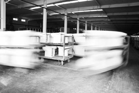 closestool: LUANNAN COUNTY - JANUARY 5: The worker and ceramic closestool products assemblies in a warehouse, in the ZhongTong Ceramics Co., Ltd. January 5, 2014, Luannan county, Hebei Province, China.  Editorial