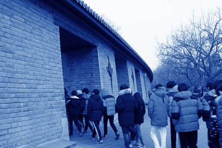 BEIJING - JANUARY 17  The fence and tourists in the temple of heaven park, on January 17, 2014, Beijing, China