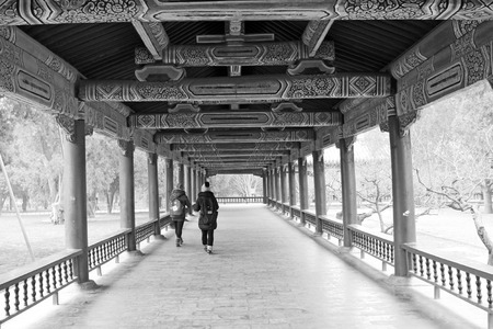 BEIJING - JANUARY 17: The long corridor and tourists in the temple of heaven park, on January 17, 2014, Beijing, China.