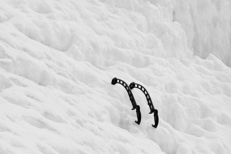 ice axe: ice axe on the ice and snow, closeup of photo Stock Photo