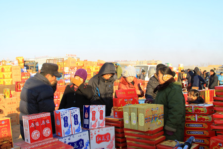 bargaining: LUANNAN COUNTY - JANUARY 28: The customer and vendor in bargaining, before a liquor stalls, on january 28, 2014, Luannan county, Hebei province, China.