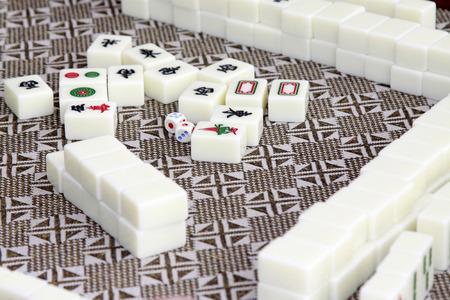 closeup of mahjong tiles in a desk photo