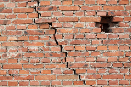 dangerous wall with cracks