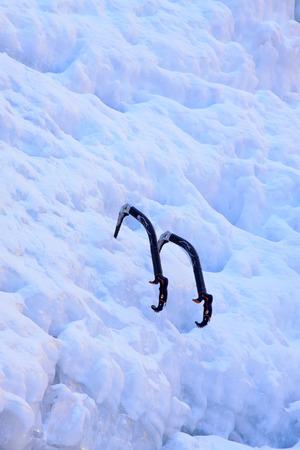 ice axe: ice axe on the ice and snow, closeup of photo Stock Photo
