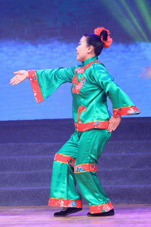 TANGSHAN - JANUARY 26: The ancient costume PingJu performance on stage, January 26, 2014, tangshan, china.