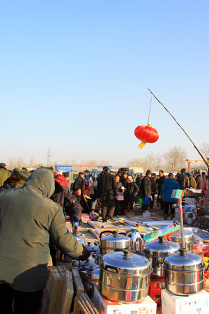 small articles: LUANNAN COUNTY - JANUARY 28: The customer and vendor in bargaining, before a hardware small articles daily use stalls, on january 28, 2014, Luannan county, Hebei province, China. Editorial