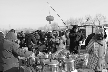 small articles: LUANNAN COUNTY - JANUARY 28: The customer and vendor in bargaining, before a hardware small articles daily use stalls, on january 28, 2014, Luannan county, Hebei province, China.